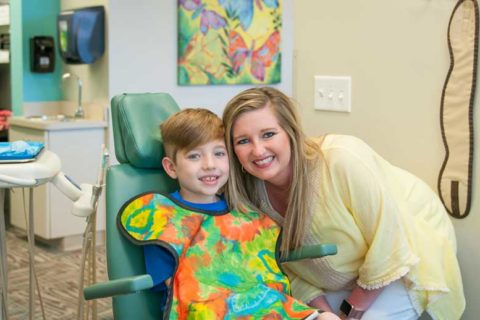 Little boy in dentist clinic with Female dentist